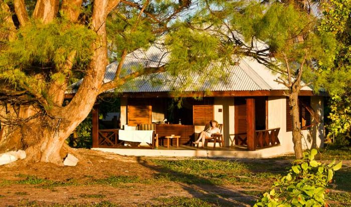 Guest enjoying some afternoon sunlight from their bedroom terrace at Bird Island Seychelles