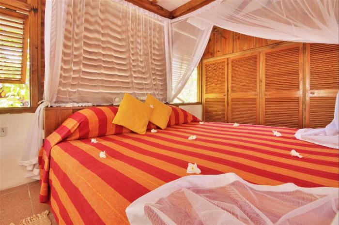 Double bed of a Bird Island Seychelles Villa