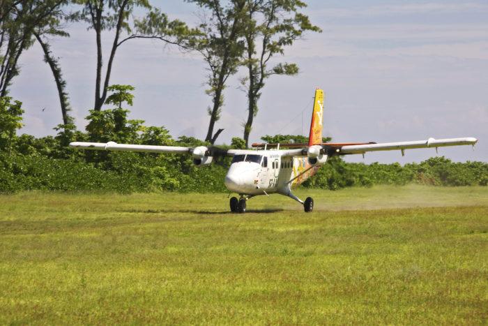 Air Seychelles De Havilland Twin Otter landing on Bird Island Seychelles